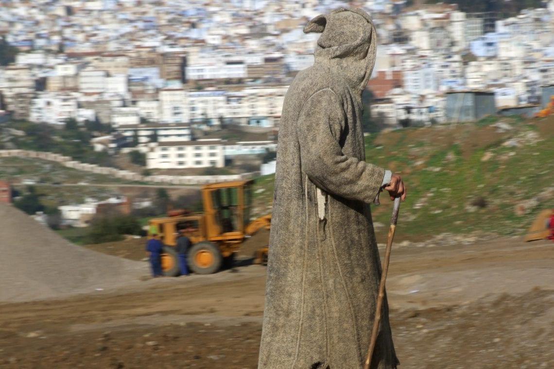 banjul challenge berber man walking along the side of the road