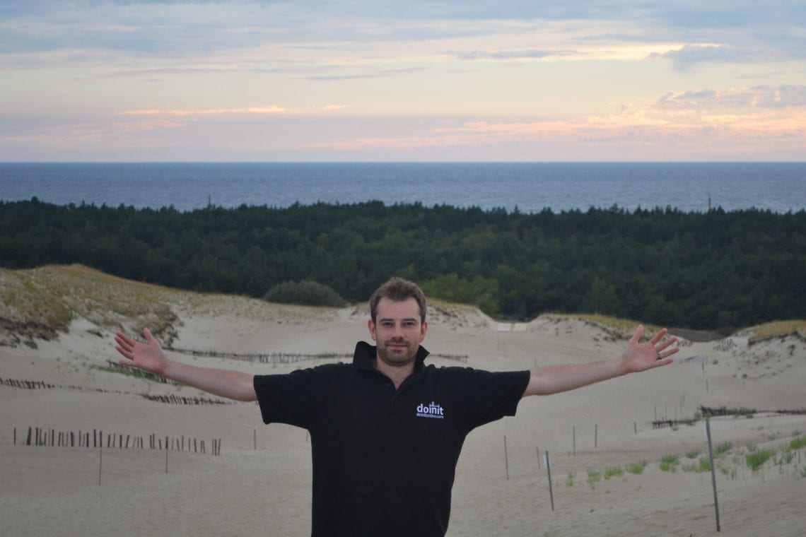 curonian spit dan standing on sand dunes