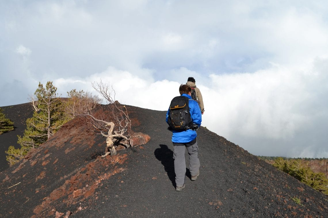 etna andy walking over the mounds