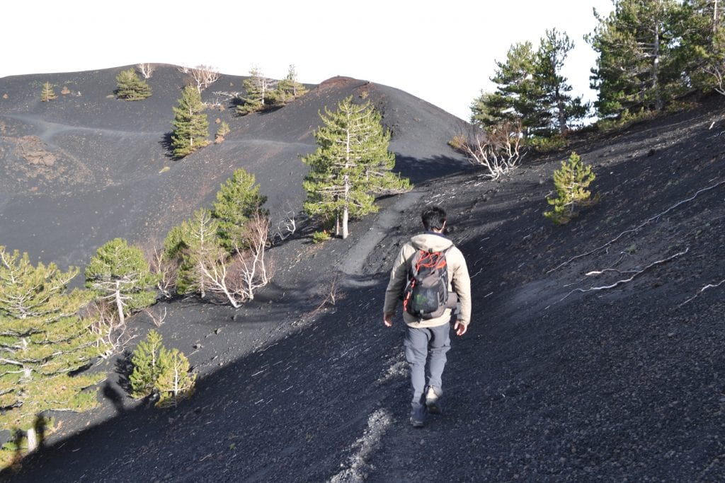 etna our guide leading the way amongs mounts of volcanic ash