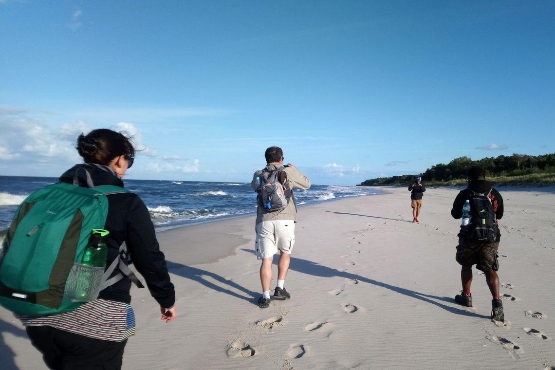 hel walking on the beach