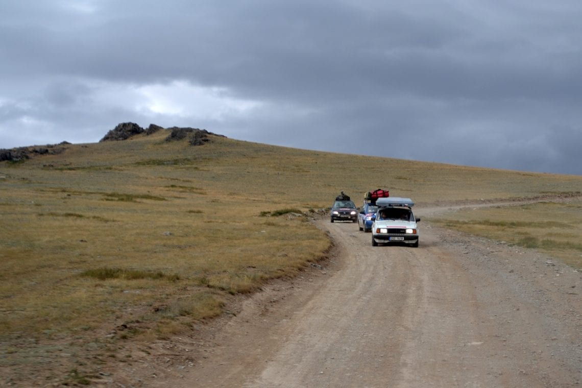 mongol rally convoy on a dirt track in mongolia