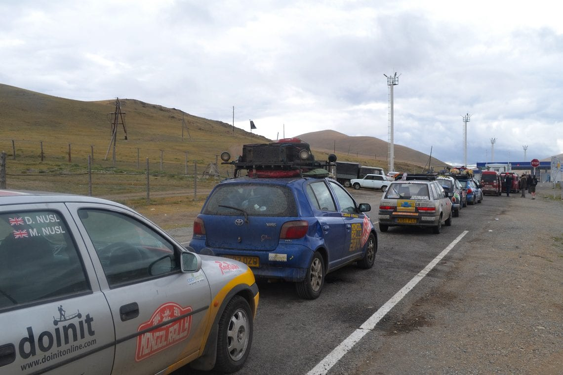 mongol rally the long cue to get into mongolia at the boarder