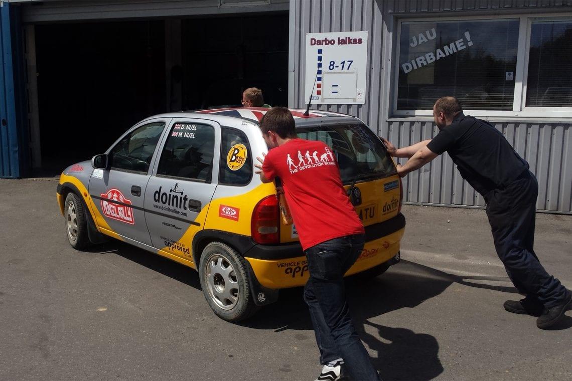 mongol rally epilgue pushing our car into the garage