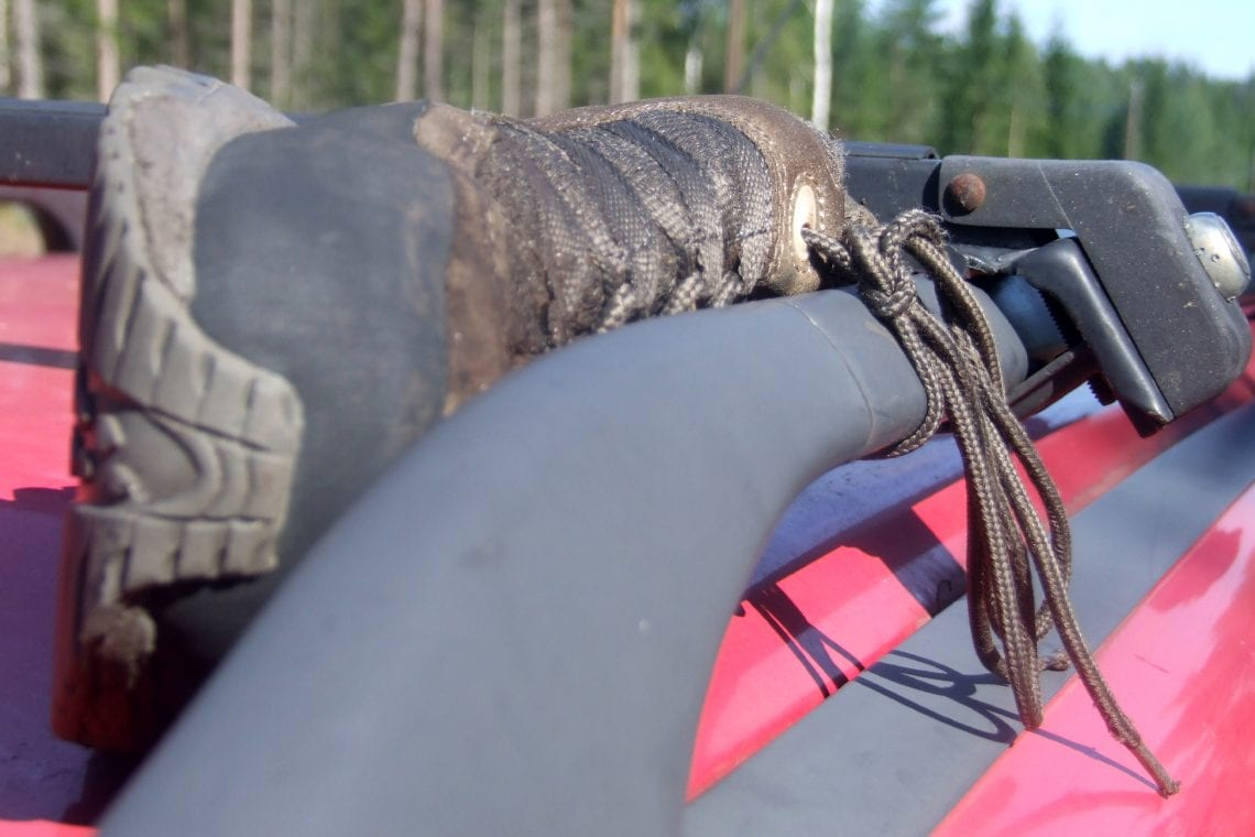 murmansk challenge drying my boots on the car roof rack