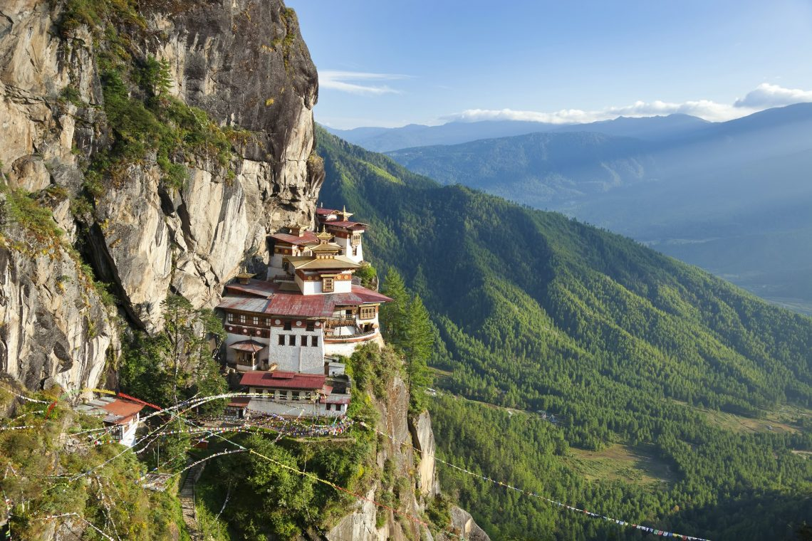 Himalayan Buddhist temple complex perched on a vertical rockface.