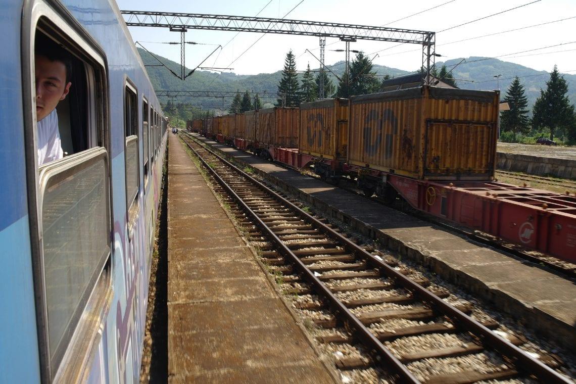 belgrade to budva on the train passing cargo trains