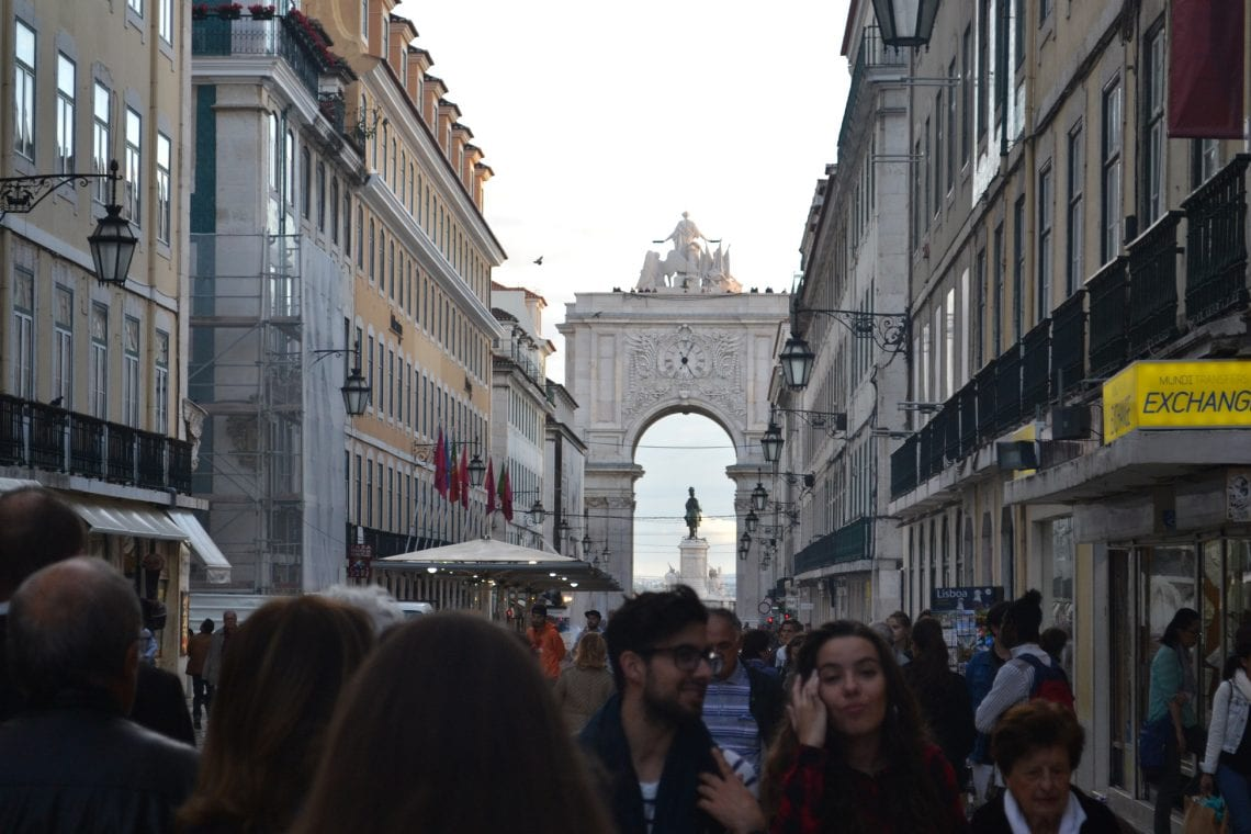 lisbon and porto busy street walk to the triumphal arch