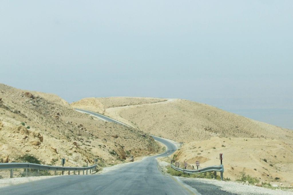 middle east backpack driving through jordan