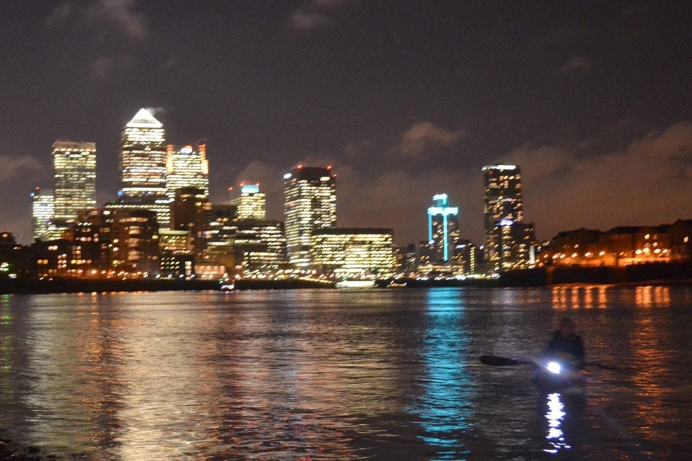 night time paddle canary wharf