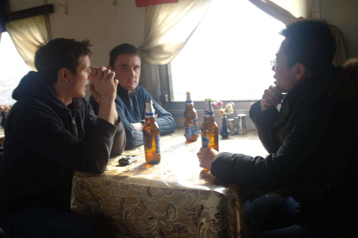 north korea a few beers on the train into dprk