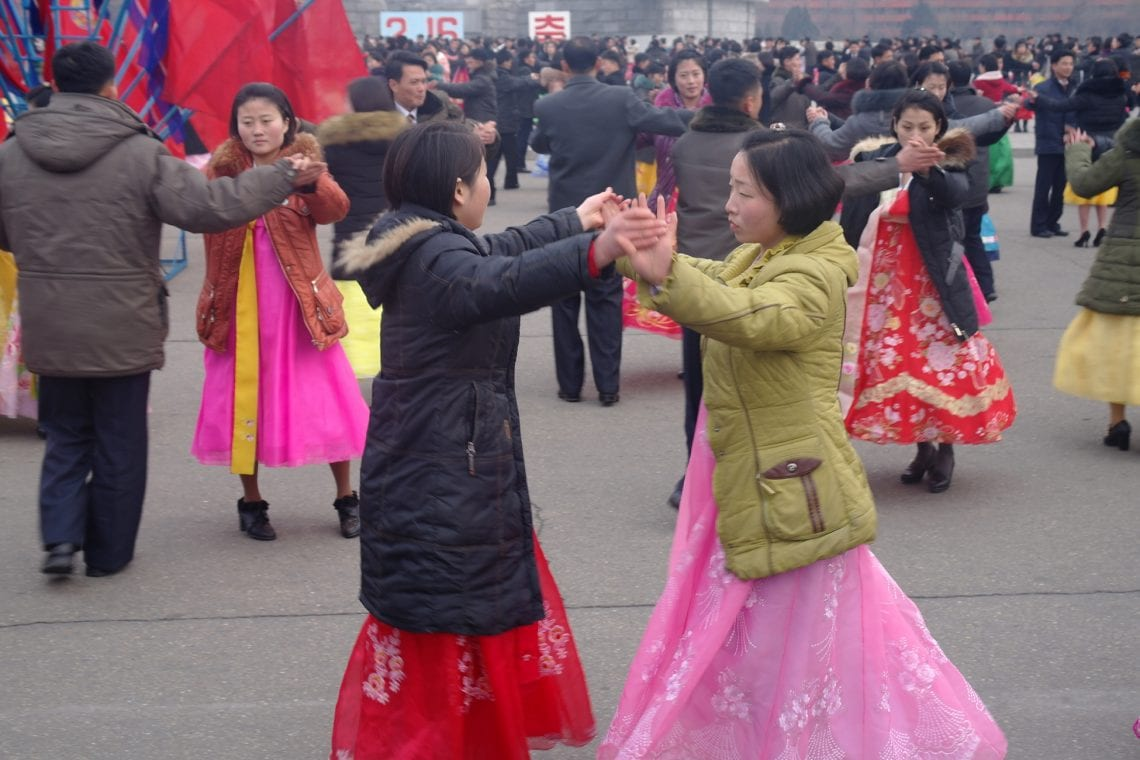 north korea people danceing on the square