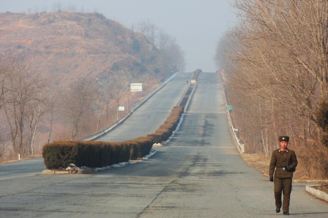 north korea soilder walking along the highway