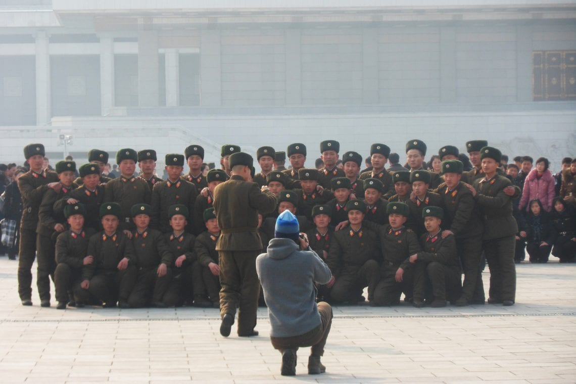north korea soldiers and tourists taking photos