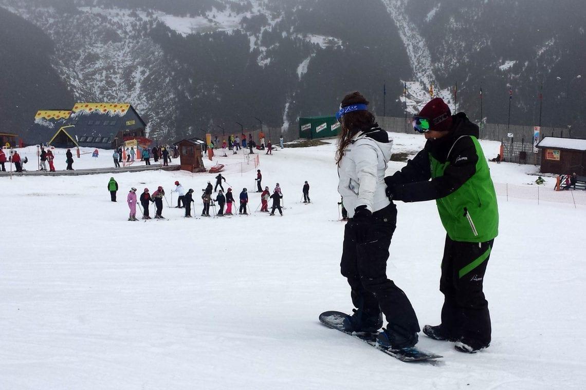 snowboard school emma haveing a lesson