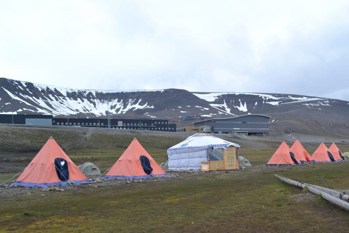 svalbard campsite with airport in the background